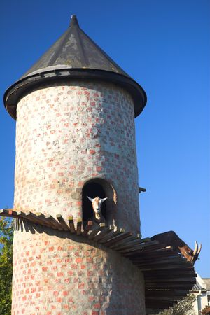 billygoat: Billy goat in a climbing tower against a blue sky � Fairview, Paarl, South Africa