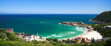 Llandudno beach and popular surf spot in the Western Cape of South Africa. Rather large and secluded beach with shallow water and a blue sky with copy space