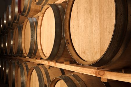 коньяк: Stacked Oak barrels for maturing red wine and brandy in a cooling cellar. Made from American and Canadian oak and stacked in rows. (low noise HDR file � no noise reduction filterssoftware used)