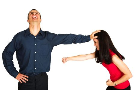 office politics: Businessman holding a female coworker away who is trying to hit him while laughing manically. The couple is isolated on white. Image can be used for office politics or keeping woman out of management areas or rising in the workplace. Stock Photo