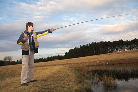 A fly fisherman casting a line in Dullstroom, South Africa Stock Photo