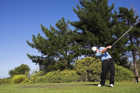 Man playing golf. Stock Photo