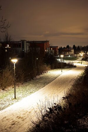 Desolate streets of Munich at nightime, covered in snow. photo