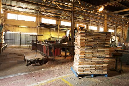 Pile of stacked wood in a workshop Stock Photo