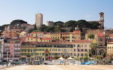 editorial: The skyline from the harbour square in Cannes, France - People in background, Editorial use only