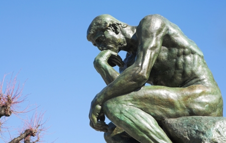 A copy of the famous bronze sculpture of Auguste Rodin � The Thinker (originally called  The Poet) in St Paul, France photo