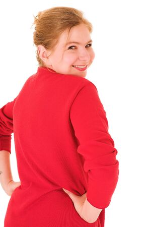viewer: Blond adult businesswoman in red pullover looking over her shoulder. Isolated on white. Woman is smiling at viewer Stock Photo