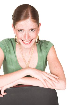 short sleeved: A tall smiling Caucasian businesswoman with brown trousers and a short sleeved green top and gold jewelry. Isolated on white is smiling at the viewer Stock Photo