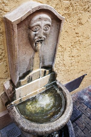 Old ornate public drinking fountain in Cannes, France photo