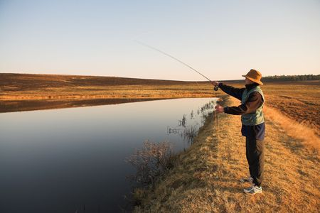 A fly fisherman casting a line in Dullstroom, South Africa photo