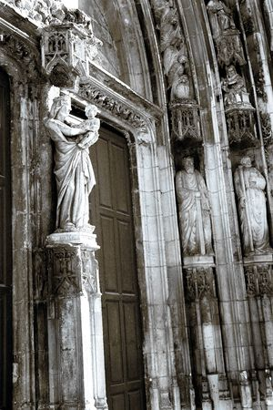 triptych: The wooden doors and statues of Cathedrale Sainte Sauveur in Aix-en-Provence, France - Black and white with blue cast - duotone