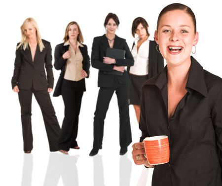 A group of young modern businesswoman of different backgrounds, on a white background. For use as a business background. The person in front of the business group is sharp, while the back row is slightly blurred. photo
