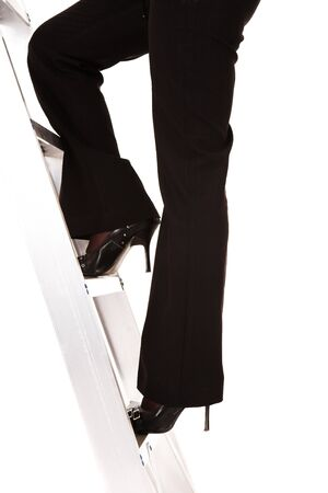 stepping: Businesswoman in stilettos climbing the ladder to success � Isolated on white background Stock Photo