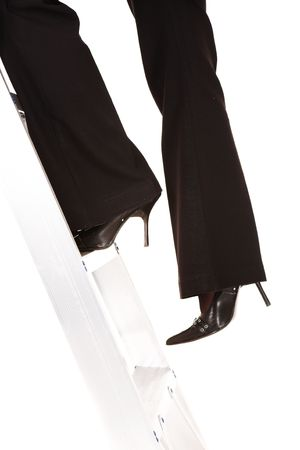 Businesswoman in stilettos climbing the ladder to success – Isolated on white background Stock Photo