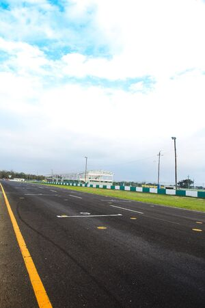 race track: Starting grid in front of the pit lane of Killarney Race Track in the Western Cape, South Africa. Cloudy and wet race day.