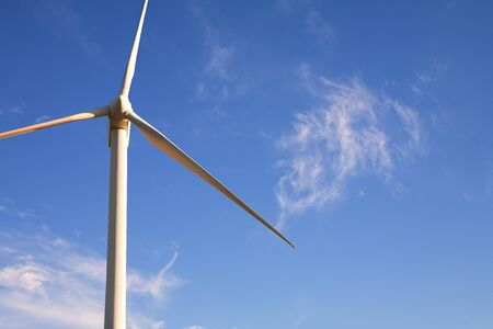 windpower: Wind powered electricity generator standing against the blue sky