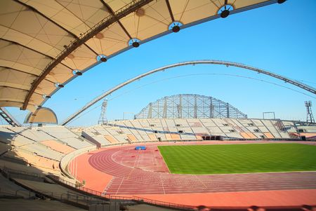 proposed: Inside Khalifa sports stadium in Doha, Qatar where the 2006 Asian games were hosted and location for the proposed 2016 sports competition Games (wide angle lens distortion on edges) Editorial