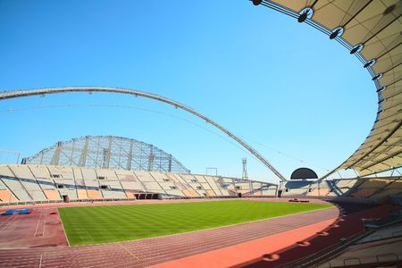 Inside Khalifa sports stadium in Doha, Qatar where the 2006 Asian games were hosted and location for the proposed 2016 sports competition Games (wide angle lens distortion on edges) Editorial