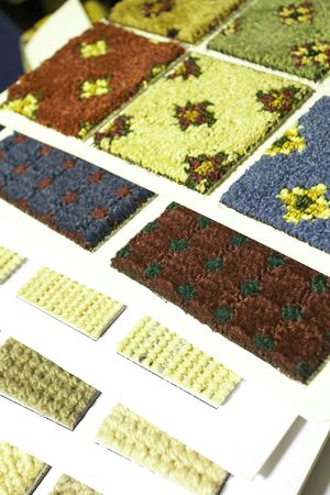 Colorful material swatches and samples for carpeting as used by interior decorators (shallow Depth of Field Ð focus on red and green swatch) photo