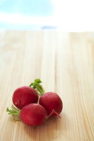 Fresh radish on a wooden cutting board Stock Photo - 2619240