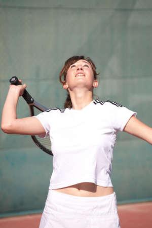 sportswoman: Young women playing tennis in the sun