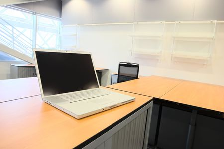 Empty office with new modern office furniture, including desks, cupboards, filing cabinets and chairs. Two orange chairs facing out. HDR type image Stock Photo - 2871603