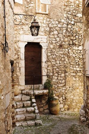 vence: Buildings with windows and doors in the quaint little French hilltop village of Saint-Paul de Vence, Southern France,  Alpes Maritimes, next to the Mediterranean sea