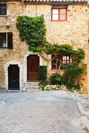 alpes maritimes: Buildings with windows and doors in the quaint little French hilltop village of Saint-Paul de Vence, Southern France,  Alpes Maritimes, next to the Mediterranean sea