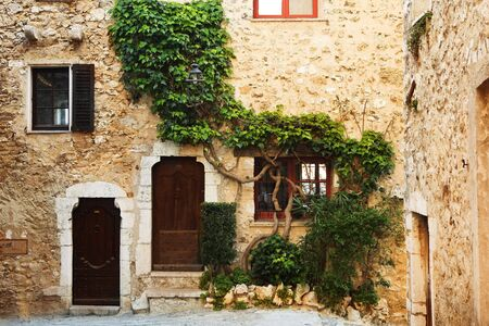 vence: Buildings with windows and doors in the quaint little French hilltop village of Saint-Paul de Vence, Southern France,  Alpes Maritimes, next to the Mediterranean sea - A Heritage Site Stock Photo