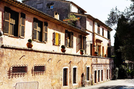 alpes maritimes: Buildings with windows and doors in the quaint little French hilltop village of Saint-Paul de Vence, Southern France,  Alpes Maritimes, next to the Mediterranean sea - A Heritage Site Stock Photo