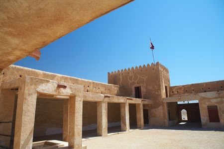 persian gulf: Rebuilt historic Fort Zubarah (Al Zubara) in North East of the deserts of Qatar on the edge of the Persian gulf on a sunny summer day