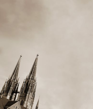 steeples: Cathedral steeples of The Dom Cathedral in Regensburg, Germany during a sunny day in winter. Black and White  Stock Photo