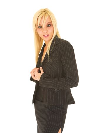 pencil skirt: Sexy young adult Caucasian businesswoman in black pinstripe pencil skirt and suit jacket on a white background.