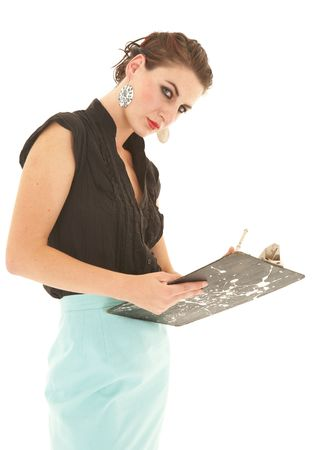 Sexy young adult Caucasian businesswoman in a tight black sexy blouse on a white background with a pen and clipboard  photo