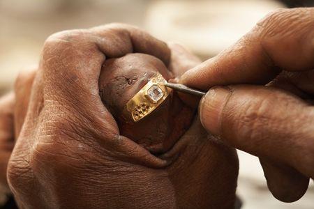 Goldsmith designing a ring photo