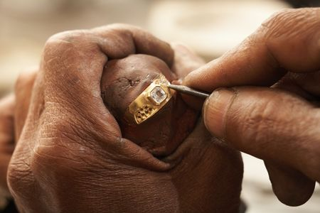 Goldsmith designing a ring