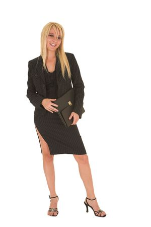 Sexy young adult Caucasian businesswoman in black pinstripe pencil skirt and suit jacket on a white background.
