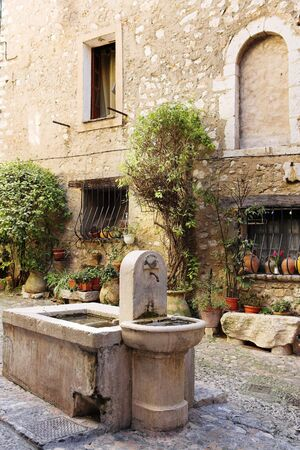 maritimes: Fresh water fountain in the centre of the quaint little French hilltop village of Saint-Paul de Vence, Southern France,  Alpes Maritimes, next to the Mediterranean sea - A Heritage Site