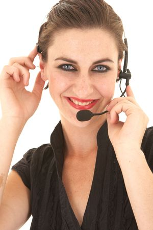 Sexy young adult Caucasian businesswoman in a tight black sexy blouse on a white background with a telephone headset  photo