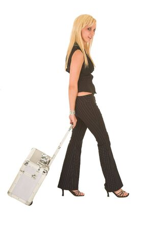 red pants: Sexy young adult Caucasian businesswoman in black pinstripe pants and suit top on a white background