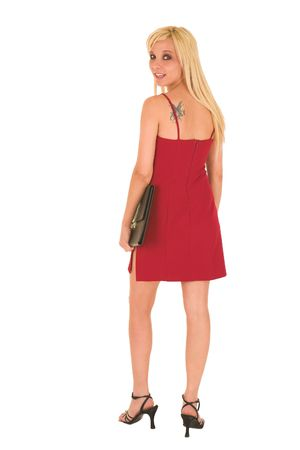 Sexy young adult Caucasian businesswoman in a short red dress with a black leather folder on a white background  photo