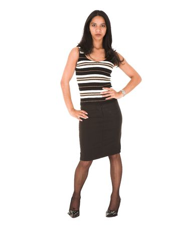 pencil skirt: Beautiful young adult Indian businesswoman with dark skin and dark straight long hair, brown eyes and pink lips, wearing a black pencil skirt and striped top with stockings and black stilettos Stock Photo