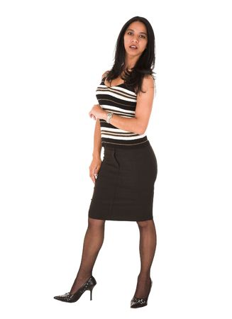 lip pencil: Beautiful young adult Indian businesswoman with dark skin and dark straight long hair, brown eyes and pink lips, wearing a black pencil skirt and striped top with stockings and black stilettos Stock Photo