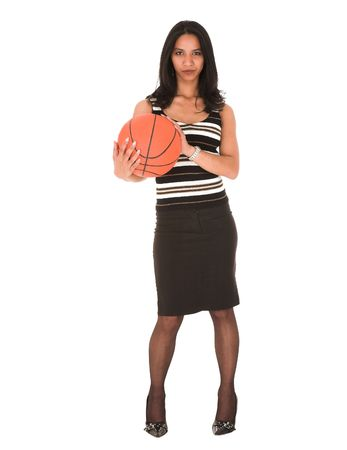 Beautiful young adult Indian businesswoman with dark skin and dark straight long hair, brown eyes and pink lips, wearing a black pencil skirt and striped top with stockings and black stilettos holding a basketball photo
