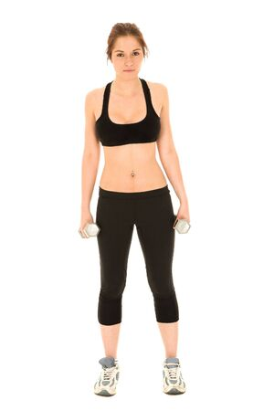 Sexy young adult Caucasian woman in a black training wear with small weights. NOT ISOLATED  photo