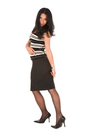 Beautiful young adult Indian businesswoman with dark skin and dark straight long hair, brown eyes and pink lips, wearing a black pencil skirt and striped top with stockings and black stilettos photo