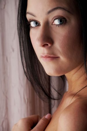 Sexy young adult Caucasian woman with black hair, smooth skin and blue contact lenses in her eyes. Stock Photo - 3233410