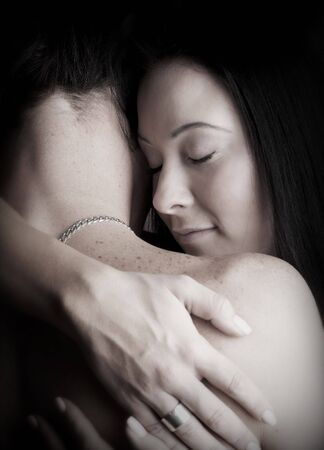 Young adult Caucasian couple in passionate embrace and undressing each other during ual foreplay Stock Photo - 3341677