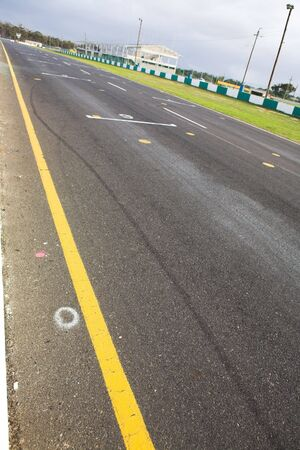 Starting grid in front of the pit lane of Killarney Race Track in the Western Cape, South Africa. Cloudy and wet race day. photo