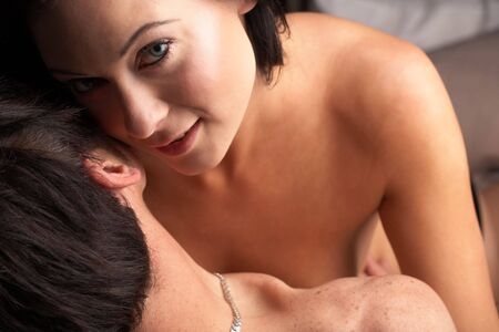 Young adult Caucasian couple in passionate embrace and undressing each other during ual foreplay Stock Photo - 3491615